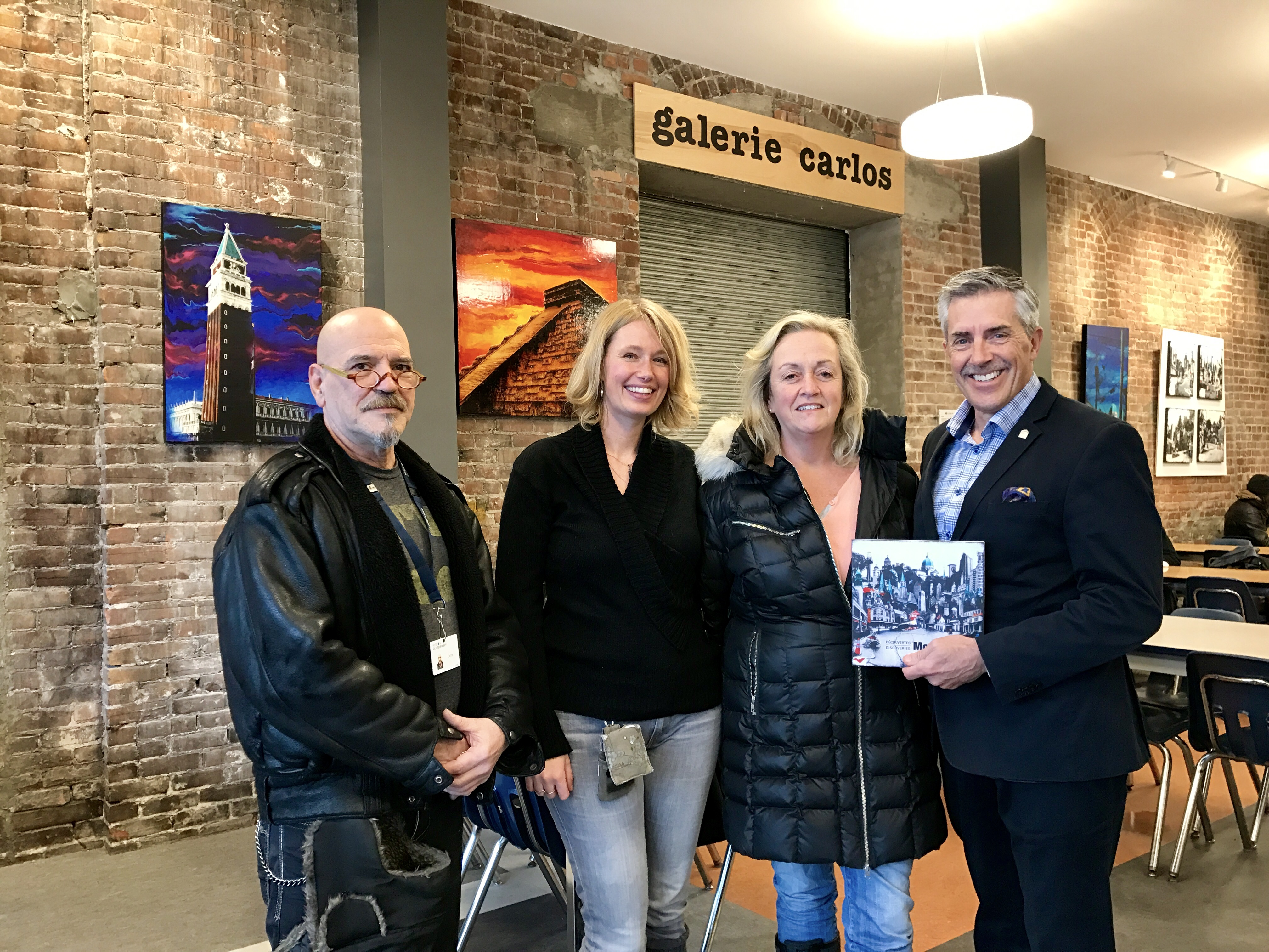 Carlos Anglarill, counselor at the Mission and founder of Gallery Carlos, Denise Buisman Pilger, contributing artist, Karen Hosker, contributing artist and Gallerie Carlos curator and Matthew Pearce, President and CEO of Old Brewery Mission.