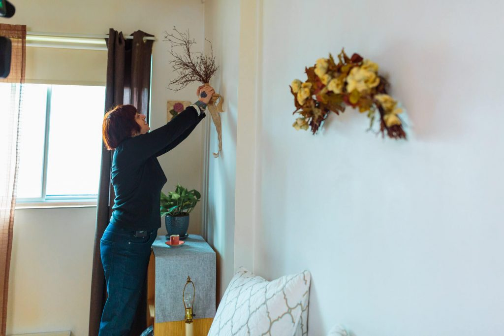 woman decorating an apartment